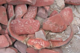 Mantras_caved_into_rock_in_Tibet