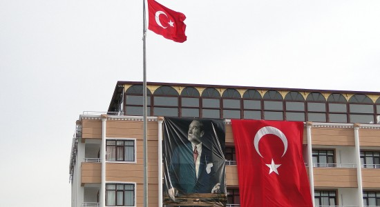 facade_with_turkish_flags_and_ataturk_banner